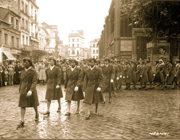 13-members-of-the-6888th-central-postal-directory-battalion-march-in-a-parade-cememony-in-honor-of-joan-darc-at-the-marketplace-where-she-burned-at-the-stake-in-may-27-1945-c.-national-a